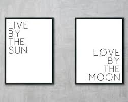 live by the sun by the moon typography wall