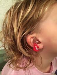 hairstyle that covers hearing aid wearer super cute craft idea a great way to store hearing aids and