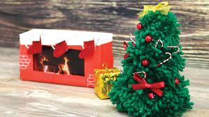 diy yarn christmas tree and cardboard fireplace