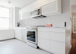 high gloss white kitchen cabinets a white ikea kitchen goes for a touch of shine