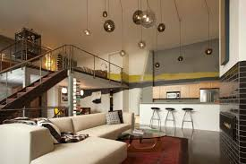 san francisco loft with double height ceiling and pendant lights