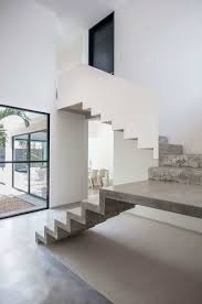 indoor concrete stair with white walls interior concrete stairs