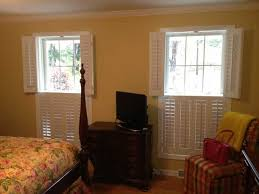 Traditional Interior Shutters Traditional Wood Shutters Double Hung In A Bedroom Jpg