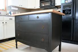 charming dresser turned into kitchen island with black paint color