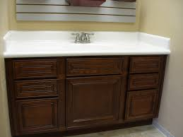 brown stained wooden vanity with drawers and white bull