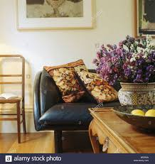 Leather And Tapestry Sofa Dried Flower Arrangement On Table In Living Room With Tapestry