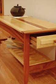 handmade two drawer mahogany and maple coffee table with shelf by