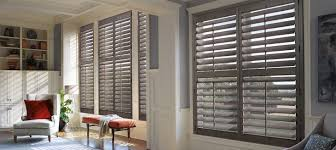 decorating plantation blinds in brown with wood floor also white