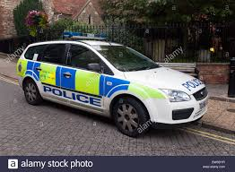 police car police car parked in a street uk stock photo royalty free image