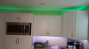 how to add crown molding to kitchen cabinets what is a good low cost solution for zwave controlled led under