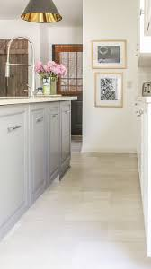 white kitchen cabinets with vinyl plank flooring lvt flooring existing tile the easy way vinyl floor
