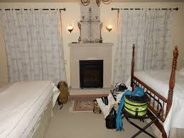 Bed And Breakfast Fireplace by Another Smaller Couch By The Fireplace And The Dining Table