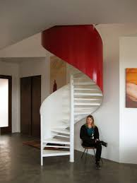 glossy spiral staircase sleek concrete floor appealing wall arts