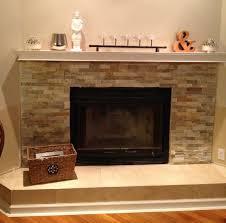 stone fireplace tv on wall wall rocks cast iron backsplash antique