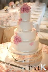 beautiful dusky pink sugar roses and butterflies on an ivory cake