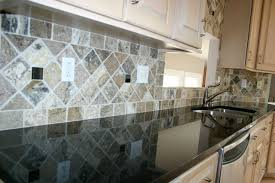 pictures of kitchen backsplashes with granite countertops black granite countertops with tile backsplash black granite