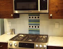 kitchen remodel using white glass 1x4 subway tile backsplash with