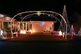 driveway entrance with dual arches christmas displays
