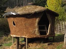 a yurt of sticks and mud hand print press
