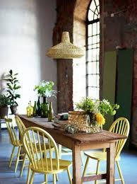 dining rom with farmhouse dining table and yellow windsor chairs