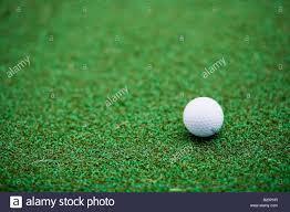 astroturf golf ball on astro turf stock photo royalty free image 18457427