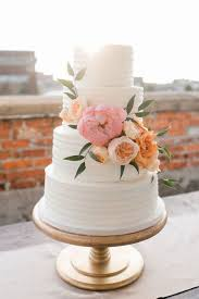 simple wedding cakes simple white textured cake with beautiful flowers let them