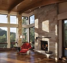 corner stone fireplace with wood ceiling beams beige sofa dark