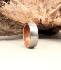 mens wedding bands that don t scratch titanium and whiskey barrel white oak wedding band