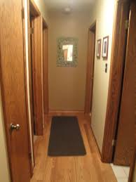 any ideas to jazz up this dark narrow hallway with lots of doors