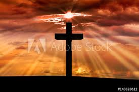 jesus wooden cross on a with orange sunset