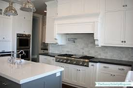 Black Kitchen Backsplash Kitchen Cabinets White Cabinets And Dark Granite Countertops