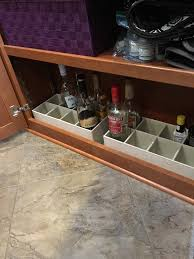 liquor bottle storage in a fifth wheel bottom shelf great for