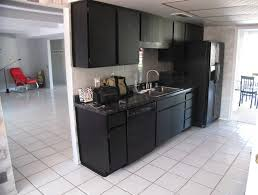 pictures of kitchens with black appliances gray kitchen cabinets black appliances stainless steel gray