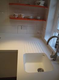 seamless corian sink and worktop with routed drainer grooves