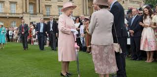 the queen along with members of the royal family hosts the first