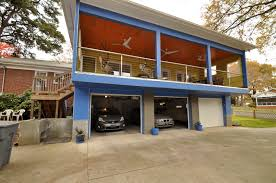 incredible three roll down garage doors for three cars also open
