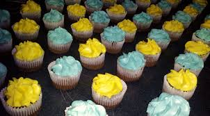 an array of mini chocolate cupcakes with blue rum and yellow