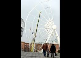 new giant wheel under construction next to the liverpool echo