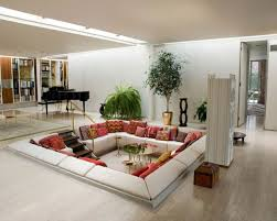 feng shui living room with sunken seat and metal elements