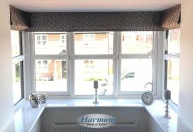 roman blinds in a square bay window harmony blinds of bolton and