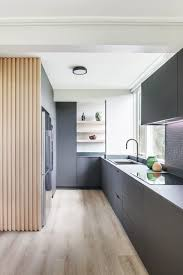 light wood kitchen cabinets with black countertops 75 beautiful kitchen with brown cabinets and black