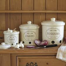 simple white ceramic canisters in round shapes kitchen ideas