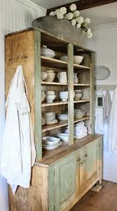 old cupboard full of ironstone and linens take a few minutes to
