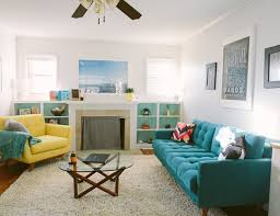 living room turquoise living room with white sofa and glass