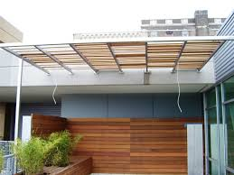 Wall Awning Patio Custom Patio Awning With Wooden Wall Pattern And Foliages