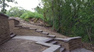 Paver Patio With Retaining Wall by Boulder Retaining Wall With Patio And Paver Stair Case Oasis