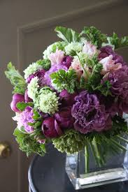 Purple Flowers Centerpieces by Compact Leaf Lined Vase Of Purple Flowers And Green Flowers
