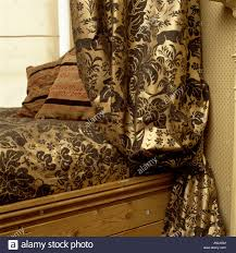 close up of patterned curtains and matching gothic style pelmet