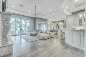 interior grey hardwood floors with light grey living room with