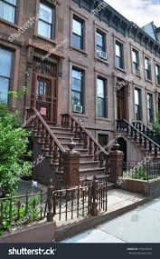 three story tall brownstone homes steps stock photo 103317074